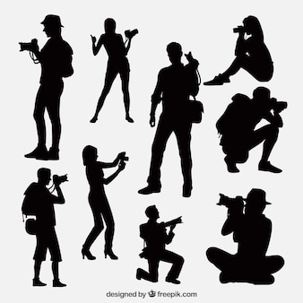 Photographers taking a photo silhouettes