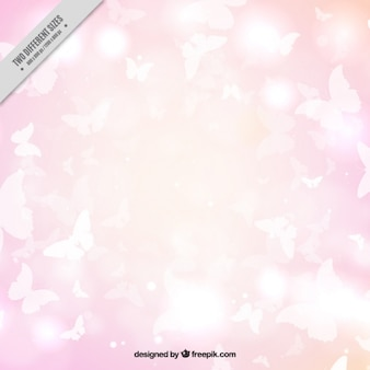 Pink background of white butterflies