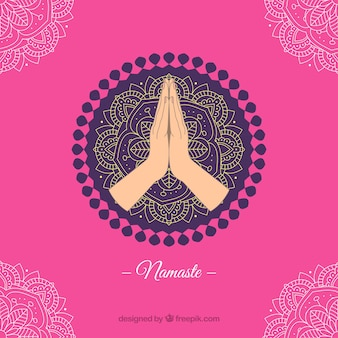 Pink background with mandala and namaste greeting
