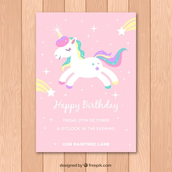 Pink birthday card with a white unicorn