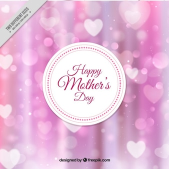 Pink blur background with hearts of mother's day