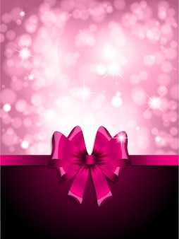 Pink bow on a glossy bokeh background