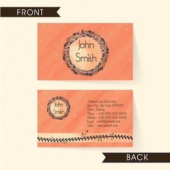 Pink business card with decorative floral wreath