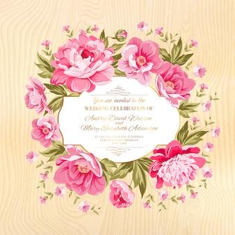 Pink floral frame on wood