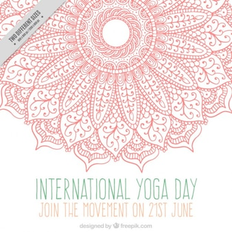 Pink ornamental hand drawn mandala yoga day background