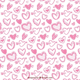 Pink pattern of hand-drawn hearts for valentines day