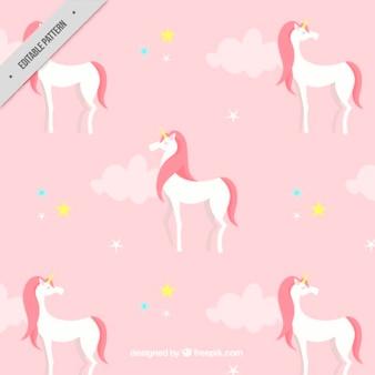Pink pattern with a white unicorn