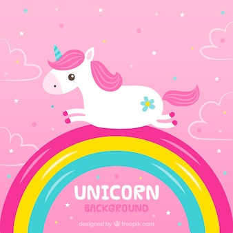 Pink unicorn background with rainbow