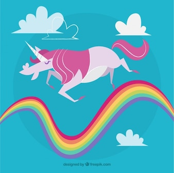 Pink unicorn walking on the rainbow
