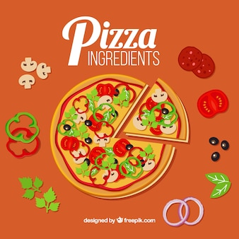 Pizza with many ingredients around