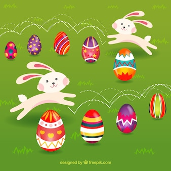 Playful bunnies with decorated eggs