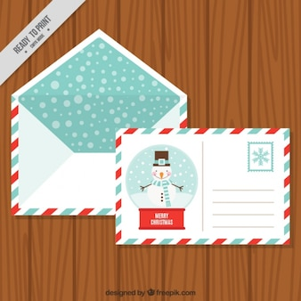 Postcard of snowman with envelope