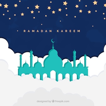 Pretty background of ramadan kareem with mosque in the sky