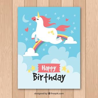Pretty birthday card with unicorn flying