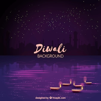 Pretty purple background of diwali with candle