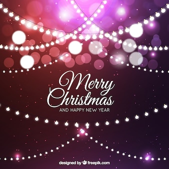 Purple background with christmas lights and bokeh effect