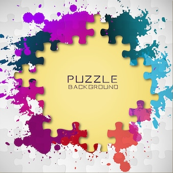 Puzzle pieces and colorful paint splashes