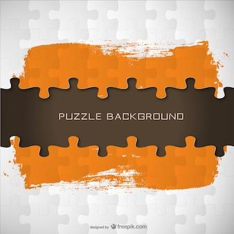 Puzzle pieces and orange brush stroke