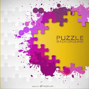 Puzzle pieces and paint splashes