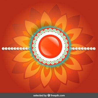 Rakhi background with orange floral jewelry