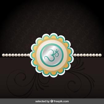 Rakhi bracelet on brown background