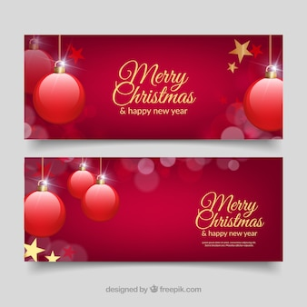 Realistic banners with red baubles for christmas