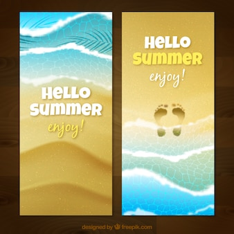 Realistic beach banners with footprints on the sand