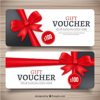 Realistic gift voucher with red decorative bow