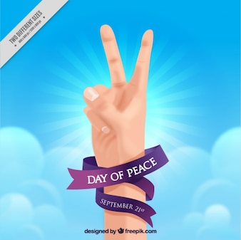 Realistic hand with a purple ribbon for international day of peace