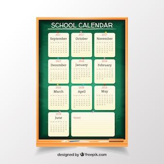 Realistic school calendar with blackboard