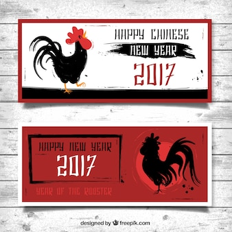 Red banners with ink roosters for chinese new year