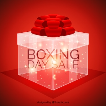 Red boxing day background with shiny gift