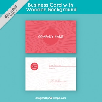 Red business card with a wooden background