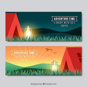 Red camping tent with grass banners