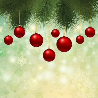 Red christmas baubles on green background