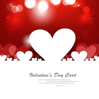 Red color greeting card with hearts