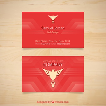 Red company card with a eagle symbol