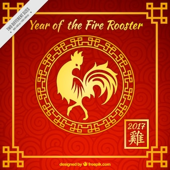 Red rooster new year background with golden details