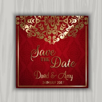 Red wedding card with golden ornaments