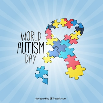 Ribbon autism day background made of puzzle pieces