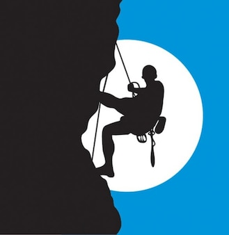 Rock climber silhouette and moon