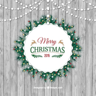 Rounded christmas wreath on a wood texture background