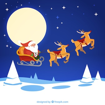 Santa claus flying in his sledge