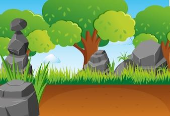 公園の岩や木がある場面