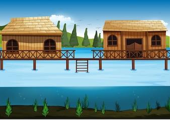 川に2つの家がある場面