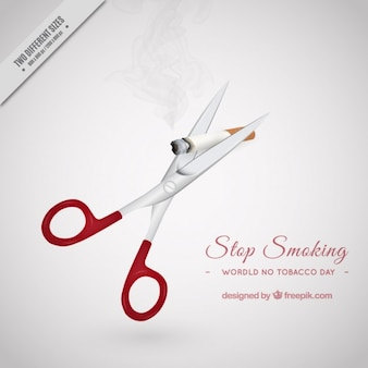 Scissors cutting a cigarrette background
