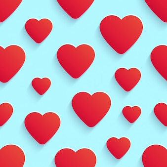 Seamless light blue background with red hearts