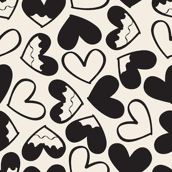 シームレスな単色抽象的な手描きの心のパターンの背景