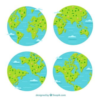 Выбор четырех земных шаров с декоративными деревьями и горами