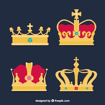 Selection of four gold crowns with colored gems